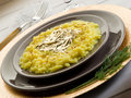 Saffron risotto with gold leaf Royalty Free Stock Photography