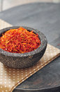 Saffron in stone bowl Stock Photo