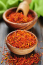 Saffron on wooden background in bowl Stock Photos