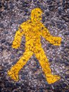 Saftey sign a yellow painted on a footpath Royalty Free Stock Photos