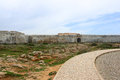 Sagres fortress in rugged terrain surround the ponta de algarve portugal Royalty Free Stock Photo