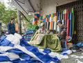 Saigon ho chi min city vho vietnam october vietnam workers sewing tarpaulins in their work place a street corner Royalty Free Stock Image