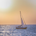 Sail boat against sea sunset colorful marine landscape Stock Photo