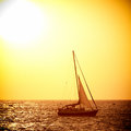 Sail boat against sea sunset colorful marine landscape Royalty Free Stock Image