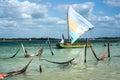 Sail boat and hammocks in Jericoacoara, Brazi Royalty Free Stock Photo