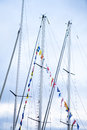 Sail boat masts decorated with flags Royalty Free Stock Photo