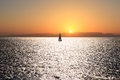 Sail boat on a sunset Stock Images