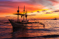 Sail boat at sunset sea, boracay island Royalty Free Stock Photo