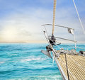 Sail boats on ocean yacht sailing to the sunset Royalty Free Stock Photography
