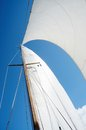 Sail and mast on yacht view from deck of boat sunny day Royalty Free Stock Photos