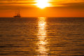 Sail ship silhouette at sea and sun Royalty Free Stock Photo