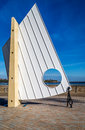 The sail in south shields modern sculpture on seafront with a view of tynemouth priory ruins middle Royalty Free Stock Photography