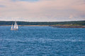 Sailboat in blue waters near the coast of maine Royalty Free Stock Images