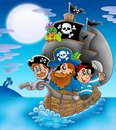 Sailboat with cartoon pirates at night Stock Photography
