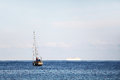 A sailboat and a cruise ship in the ocean Royalty Free Stock Photo