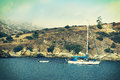 Sailboat a and dingy anchored in a bay at catalina island Royalty Free Stock Images