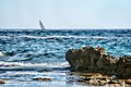 Sailboat at horizon Stock Photos