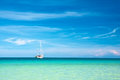 Sailboat on the horizon a sunny day Royalty Free Stock Photo