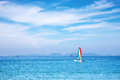 Sailboat on the horizon a sunny day Stock Photos