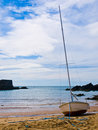 Sailboat on inlet beach Royalty Free Stock Photo