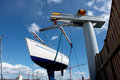 Sailboat lift up by a boat lifter Stock Images
