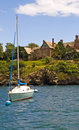 Sailboat and mansion Royalty Free Stock Photography