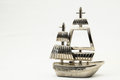 Sailboat metal sailing boat figurine on a white background Royalty Free Stock Images