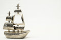 Sailboat metal sailing boat figurine on a white background Stock Photography