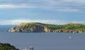 Sailboat navigates near Twillingate cliffs, seascape, landscape, Newfoundland, Atlantic Canada. Royalty Free Stock Photo