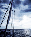 Sailboat at night luxury water transport water cruise on sail yacht yachting sport cloudy sky peaceful sea travel and vacation Stock Photo