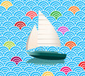 Sailboat on an ocean of waves pattern esp for shadow under boat color each wave as you wish Royalty Free Stock Photography