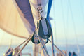 Sailboat rigging pulley details of with low depth of field Stock Image