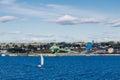 Sailboat Sailing Past Coal Shipping Operation Royalty Free Stock Photo