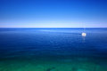 Sailboat on the sea horizon Stock Image