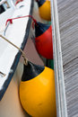 Sailboat side fenders closeup boat protection vertical shot Stock Photo