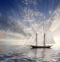 Sailboat sun and sky sunlight streaming Stock Image