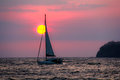 Sailboat sunset costa rica a lone against a in the pacific ocean off the coast of Stock Image