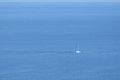 Sailboat on vast open ocean a sunny day Royalty Free Stock Photo
