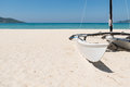 Sailboat on white sand beach in summer clear blue sky Royalty Free Stock Photo