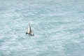 Sailboat with wind and rough sea a Royalty Free Stock Photos