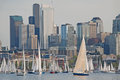 Sailboats against a seattle skyline race on lake union with the in the background Royalty Free Stock Photography
