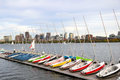 Sailboats docked. Regatta on the river. Buildings on  other side Royalty Free Stock Photo