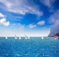 Sailboats Optimist learning to sail in Mediterranean at Denia Royalty Free Stock Photo