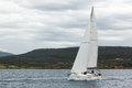 Sailboats participate in sailing regatta 12th Ellada Autumn 2014 among Greek island group in the Aegean Seа Royalty Free Stock Photo