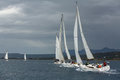 Sailboats participate in sailing regatta 12th Ellada Autumn 2014 among Greek island group in the Aegean Sea Royalty Free Stock Photo