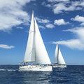 Sailboats of the regatta luxury yachts in waters sea Royalty Free Stock Photography