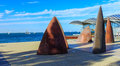 Sailboats and sculptures Royalty Free Stock Photo