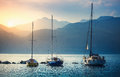 Sailers boats sailing by sea waves in evening sunset Royalty Free Stock Photo
