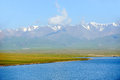 Sailimu lake with snow mountain in summer located xinjiang china Stock Images