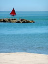 Sailing boat on the adriatic sea rocks beach and Stock Photography